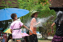 Laos-New-Year-Flour-Spay-pandulipi.net-source-https://upload.wikimedia.org/wikipedia/commons/thumb/1/11/Lao_New_Year%2C_flour_throwing.jpg/250px-Lao_New_Year%2C_flour_throwing.jpg